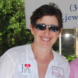 Cathy Summer in the JFS booth at the Boulder Jewish Festival