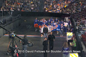Jeremy Bloom leads Albany team to open procession of athletes.