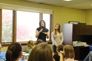 Meredith and Sofie Jacobs talk to the crowd at the Boulder JCC.
