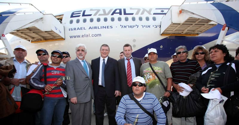 Pictured above: Upon their arrival to the Holy Land this week, 31 Chilean miners were greeted by the Chilean Ambassador to Israel Joaquin Montes (center left), EL AL President Elyezer Shkedy (center) and the Israel Minister of Tourism, Stas Misezhnikov (center right).  Photo credit: Sivan Farag