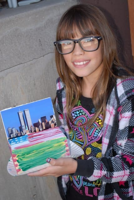 Chasen Marinoff, shows off her 9/11 charity box she made at Chabad of NW Metro Denver's Hebrew School this past Sunday.