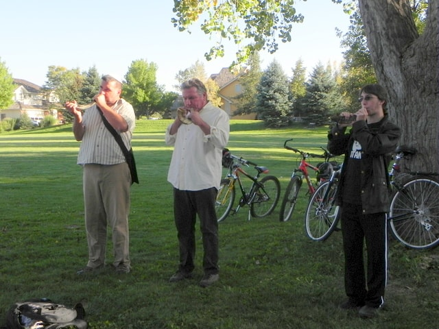 Rabbi Marc Soloway, Aron Friedman, and Ethan Fellows sound the Shofar on Rosh Hashanah afternoon at Meadow Glen Park.
