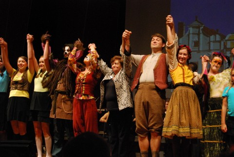 Ela Weissberger sings the victory song with the cast of CMF's production of Brundibar.