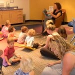 Lisa Webber reads a story about Noah's Ark at the Louisville Public Library.
