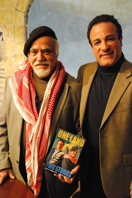 Professor Amin Kazak and Professor Shaul Gabbay with their book, One Land, Two Stories.