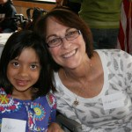 Karyn Schad with granddaughter, Avah, volunteer at the Golden West Passover