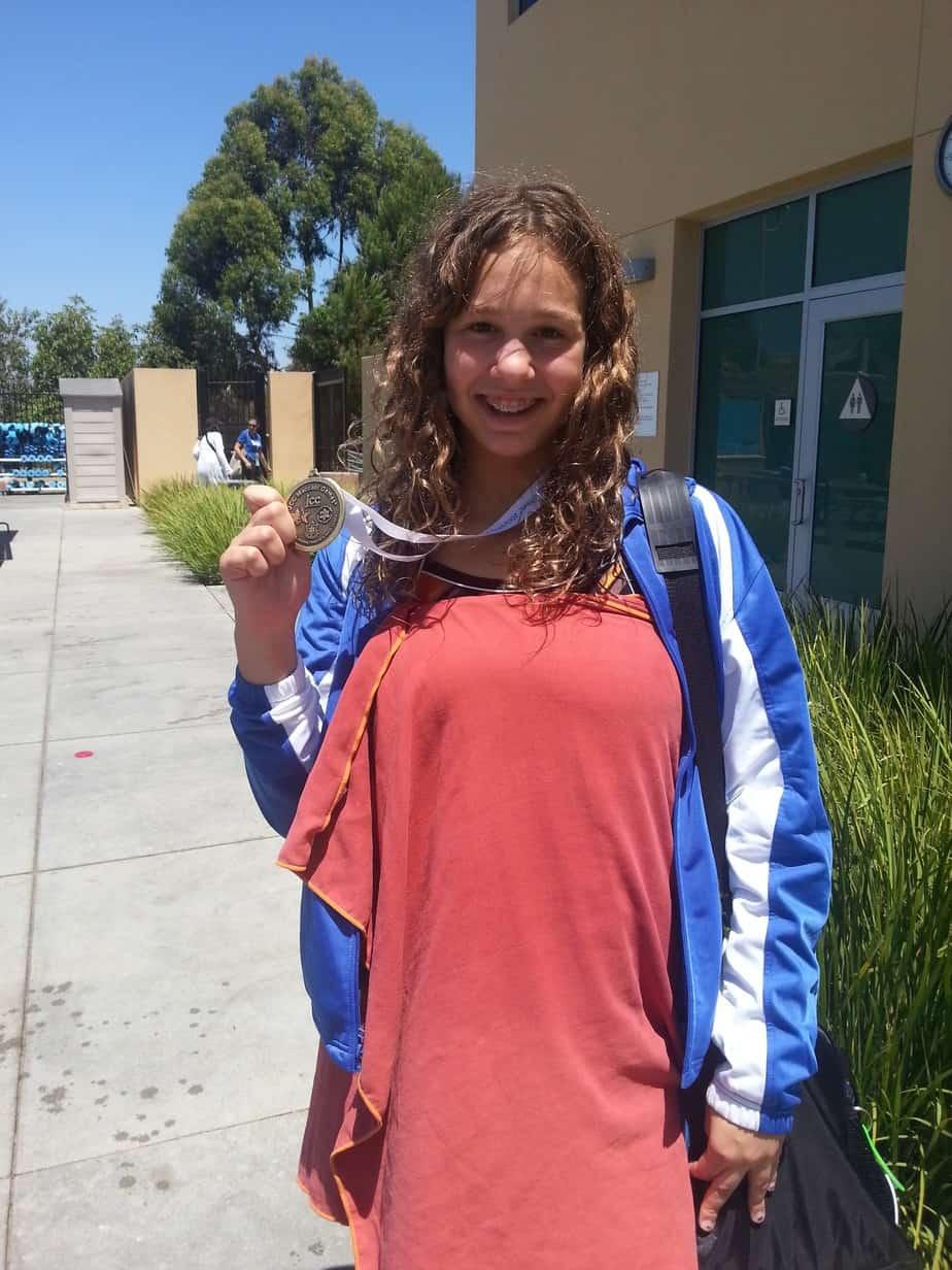 Boulder swimmer Clara Dresselhaus with her gold medal