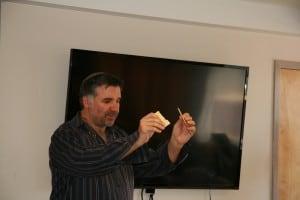 Rabbi Marc Soloway breaking the matzo at Golden West Seder.