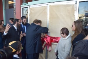 George Schaeffer cuts the ribbon opening the Center that carries his family's name.