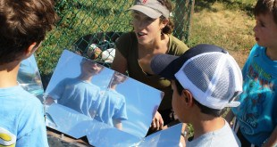 Becca with campers and solar oven_bjn