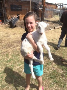 Erin Barrekette with Zahava, the baby goat she named last spring.