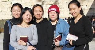 (From left) Li Yuan, Yue Ting, Li Jing, Li Chengjin and Gao Yichen standing in front of the Kotel in Jerusalem.