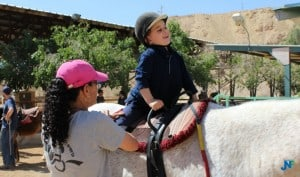 Getting ready for a ride at the Red Mountain Therapeutic Riding Center.
