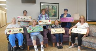 Seated: (L to R) Ann, Andrea, Barbara, and Deborah; standing:  Dotty, Ruth, and Linda with their completed signs.