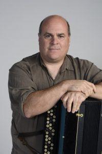 Headshot of Joshua Horowitz with an accordion
