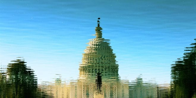 reflection of gray mosque on water