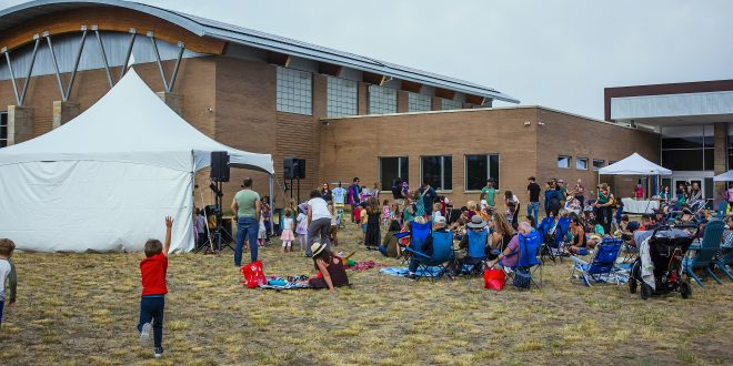 Guests of all ages set up for live music performances on the west lawn of the Boulder JCC.